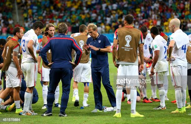 Head coach Jurgen Klinsmann of the United States speaks to his players before the extra time during the 2014 FIFA World Cup Brazil Round of 16 match...