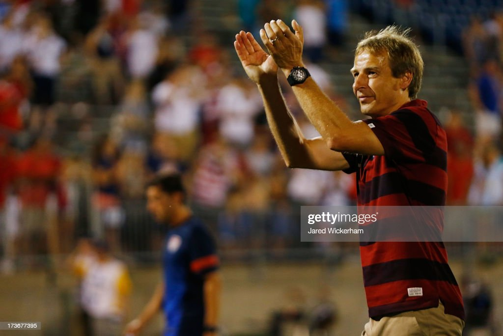 Head coach <a gi-track='captionPersonalityLinkClicked' href=/galleries/search?phrase=Jurgen+Klinsmann&family=editorial&specificpeople=228023 ng-click='$event.stopPropagation()'>Jurgen Klinsmann</a> of the United States thanks the fans following their 1-0 win against Costa Rica during the CONCACAF Gold Cup match at Rentschler Field on July 16, 2013 in East Hartford, Connecticut.