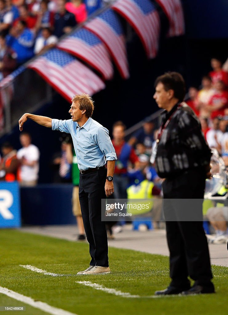 Head coach <a gi-track='captionPersonalityLinkClicked' href=/galleries/search?phrase=Jurgen+Klinsmann&family=editorial&specificpeople=228023 ng-click='$event.stopPropagation()'>Jurgen Klinsmann</a> of the USA coaches alongside head coach Ever <a gi-track='captionPersonalityLinkClicked' href=/galleries/search?phrase=Hugo+Almeida&family=editorial&specificpeople=615169 ng-click='$event.stopPropagation()'>Hugo Almeida</a> of Guatemala during the World Cup Qualifying match at LiveStrong Sporting Park on October 16, 2012 in Kansas City, Kansas.