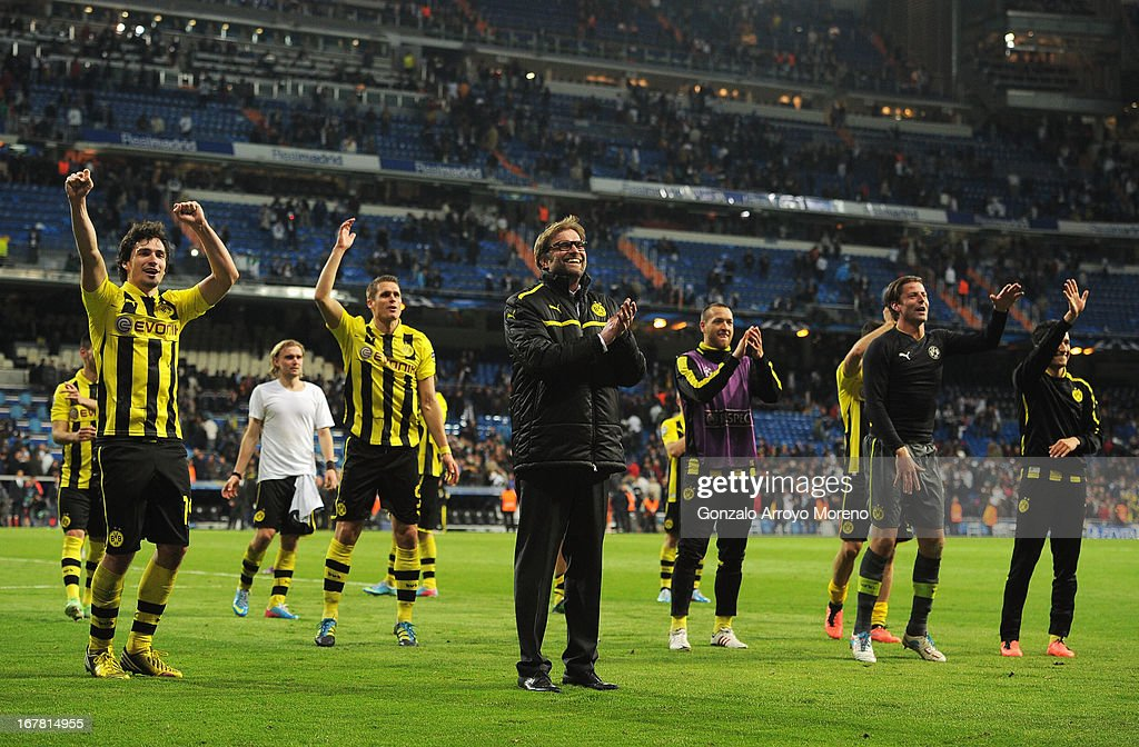 Head Coach Jurgen Klopp of Borussia Dortmund celebrates with players as his team reach the final after the UEFA Champions League Semi Final Second Leg match between Real Madrid and Borussia Dortmund at Estadio Santiago Bernabeu on April 30, 2013 in Madrid, Spain.