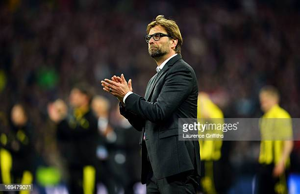 Head Coach Jurgen Klopp of Borussia Dortmund congratulates FC Bayern Muenchen after losing the UEFA Champions League final match to them at Wembley...