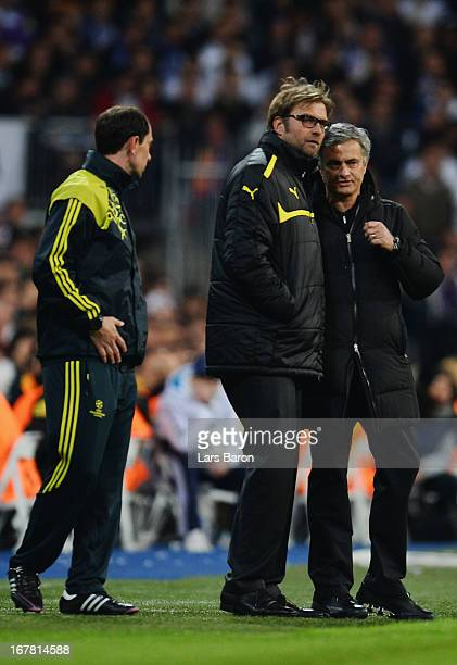Head Coach Jurgen Klopp of Borussia Dortmund in discussion with head coach Jose Mourinho of Real Madrid during the UEFA Champions League Semi Final...
