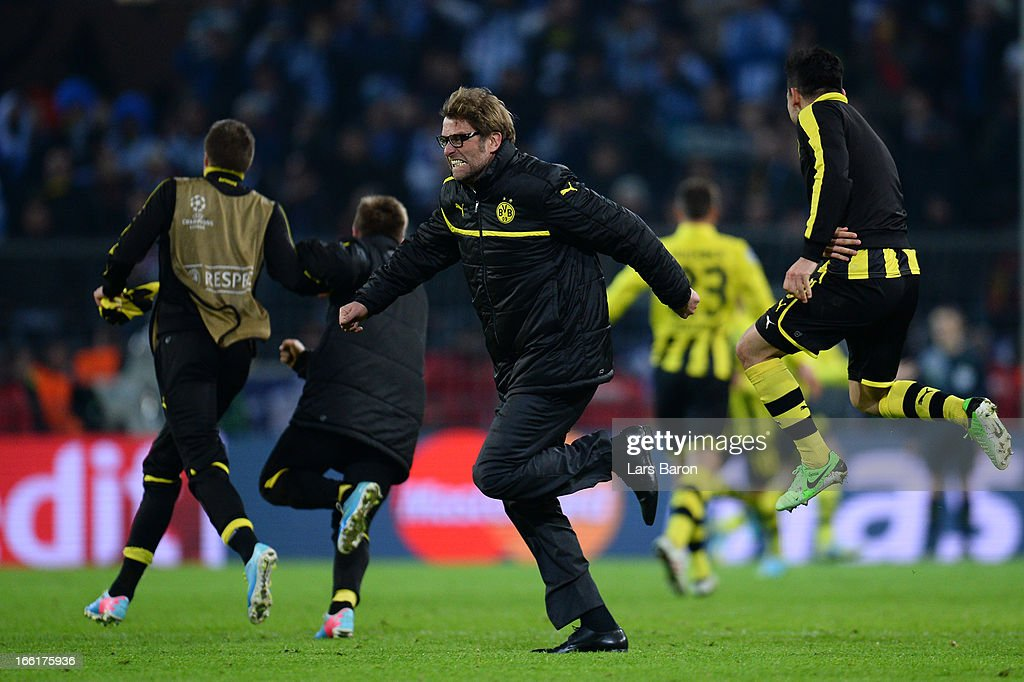 Head Coach Jurgen Klopp of Borussia Dortmund runs onto the pitch to celebrate victory at the final whistle during the UEFA Champions League quarter-final second leg match between Borussia Dortmund and Malaga at Signal Iduna Park on April 9, 2013 in Dortmund, Germany.