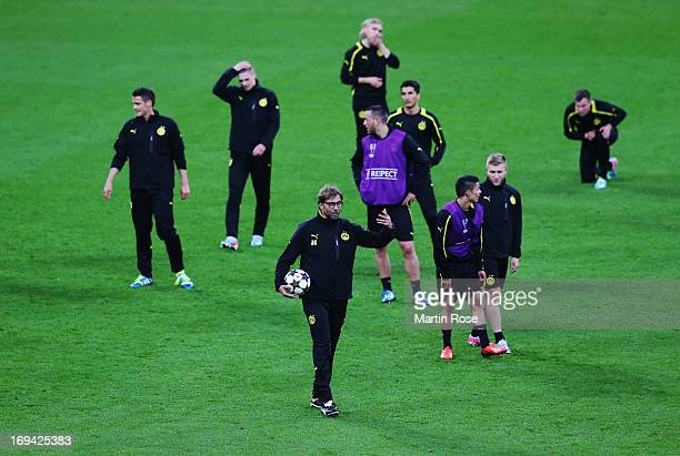 Head Coach Jurgen Klopp of Borussia Dortmund talks to the players during a Borussia Dortmund training session ahead of the UEFA Champions League...