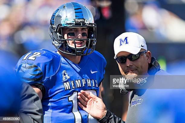 Head Coach Justin Fuente talks with Paxton Lynch of the Memphis Tigers during a game against the Ole Miss Rebels at Liberty Bowl Memorial Stadium on...