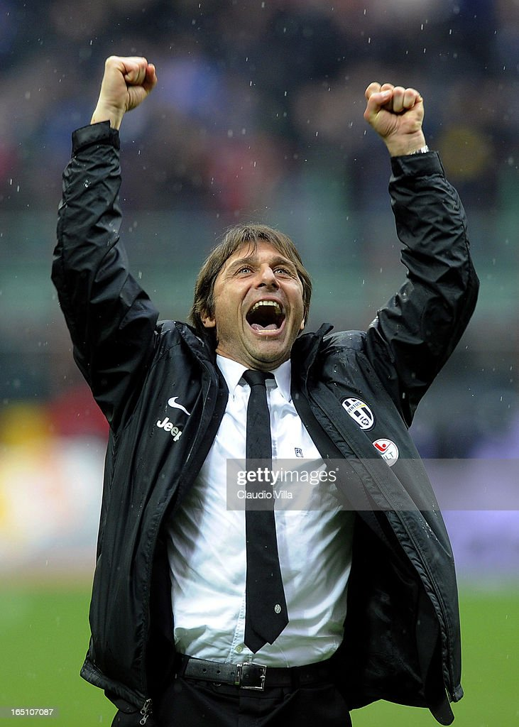 Head coach Juventus FC <a gi-track='captionPersonalityLinkClicked' href=/galleries/search?phrase=Antonio+Conte&family=editorial&specificpeople=2379002 ng-click='$event.stopPropagation()'>Antonio Conte</a> celebrates victory at the end of the Serie A match between FC Internazionale Milano and Juventus FC at San Siro Stadium on March 30, 2013 in Milan, Italy.