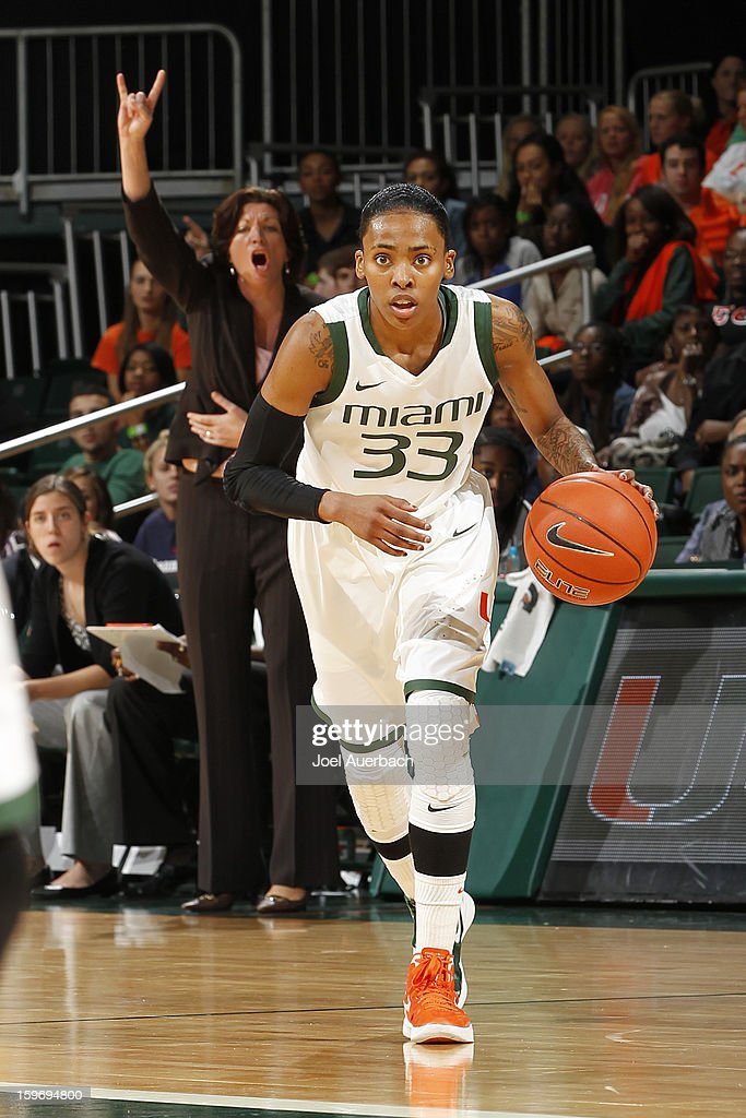 Head coach Katie Meier calls a play as Suriya McGuire #33 of the Miami Hurricanes brings the ball up court against the Georgia Tech Yellow Jackets on January 17, 2013 at the BankUnited Center in Coral Gables, Florida. Miami defeated Georgia Tech 71-65.