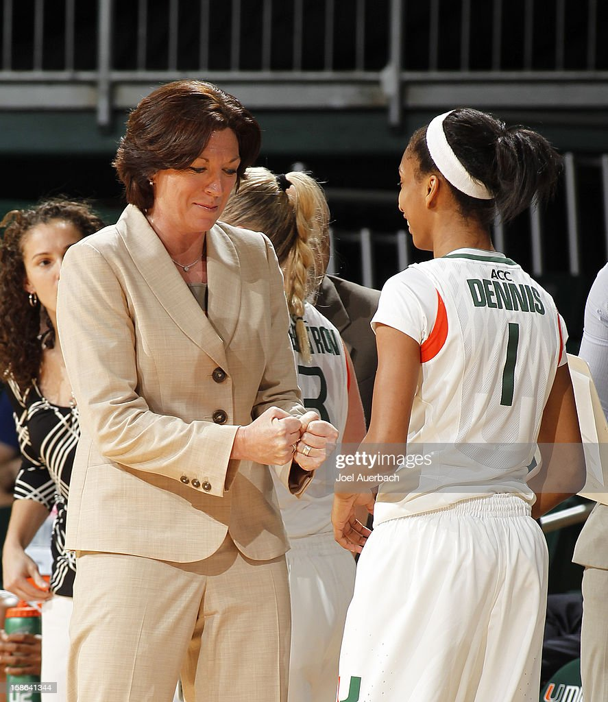 Head coach Katie Meier congratulates Caprice Dennis #1 of the Miami Hurricanes after a play against the North Carolina State Wolfpack on December 20, 2012 at the BankUnited Center in Coral Gables, Florida. The Hurricanes defeated the Wolfpack 79-53.