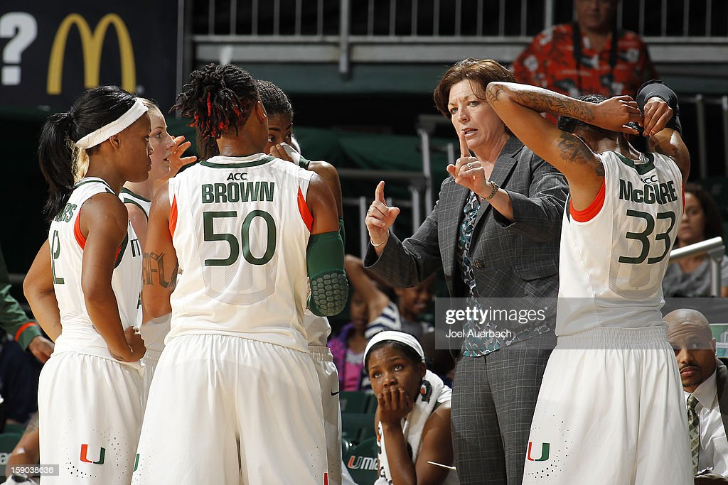 Head coach Katie Meier of the Miami Hurricanes talks t the players during a time out against the Virginia Cavaliers on January 6, 2013 at the BankUnited Center in Coral Gables, Florida.