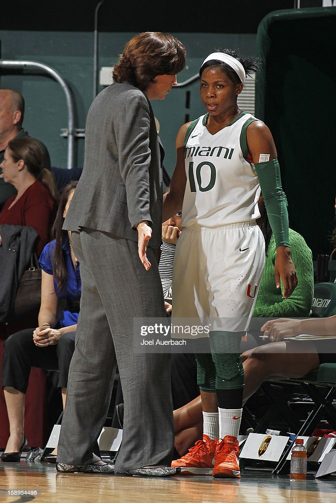 Head coach Katie Meier talks to Michelle Woods #10 of the Miami Hurricanes after being substituted for against the Clemson Lady Tigers on January 3, 2013 at the BankUnited Center in Coral Gables, Florida. miami defeated Clemson 78-56.