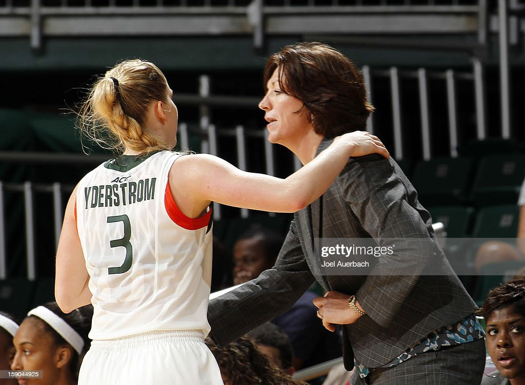 Head coach Katie Meier talks to Stefanie Yderstrom #3 of the Miami Hurricanes during a break in action against the Virginia Cavaliers on January 6, 2013 at the BankUnited Center in Coral Gables, Florida. The Hurricanes defeated the Cavaliers 58-52.