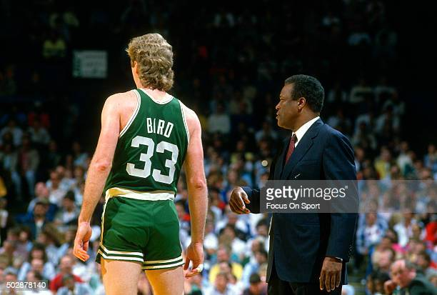 Head coach KC Jones of the Boston Celtics looks on with Larry Bird against the Washington Bullets during an NBA basketball game circa 1984 at the...