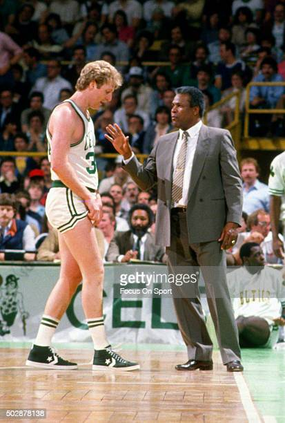 Head coach KC Jones of the Boston Celtics talks with his player Larry Bird during an NBA basketball game circa 1984 at the Boston Garden in Boston...