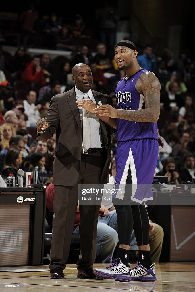 Head coach <a gi-track='captionPersonalityLinkClicked' href=/galleries/search?phrase=Keith+Smart&family=editorial&specificpeople=182522 ng-click='$event.stopPropagation()'>Keith Smart</a> of the Sacramento Kings discusses a play with <a gi-track='captionPersonalityLinkClicked' href=/galleries/search?phrase=DeMarcus+Cousins&family=editorial&specificpeople=5792008 ng-click='$event.stopPropagation()'>DeMarcus Cousins</a> #15 in the game against the Cleveland Cavaliers at The Quicken Loans Arena on January 2, 2013 in Cleveland, Ohio.