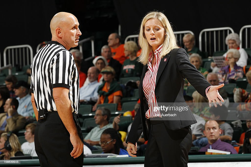 Head coach Kellie Harper of the North Carolina State Wolfpack argues a foul call with referee Luis Gonzalez against the Miami Hurricanes on December 20, 2012 at the BankUnited Center in Coral Gables, Florida. The Hurricanes defeated the Wolfpack 79-53.