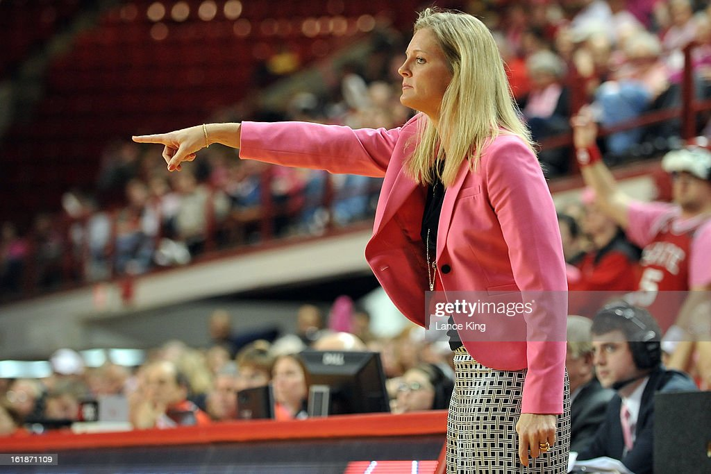 Head Coach Kellie Harper of the North Carolina State Wolfpack directs her team against the Georgia Tech Yellow Jackets at Reynolds Coliseum on February 17, 2013 in Raleigh, North Carolina.