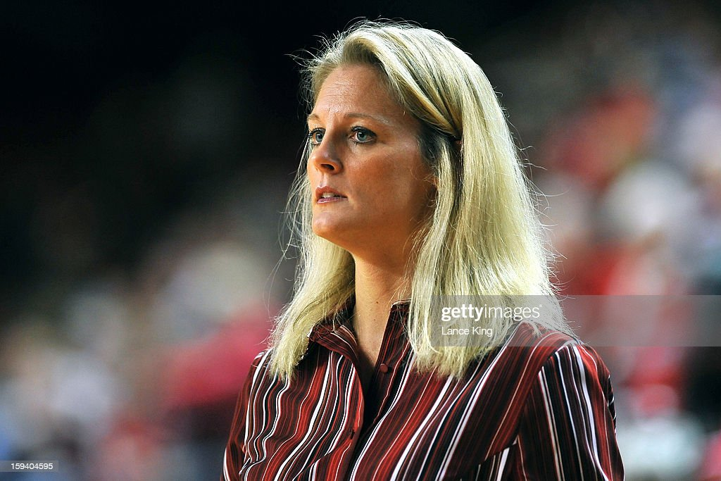 Head Coach Kellie Harper of the North Carolina State Wolfpack looks on during a game against the North Carolina Tar Heels at Reynolds Coliseum on January 10, 2013 in Raleigh, North Carolina.