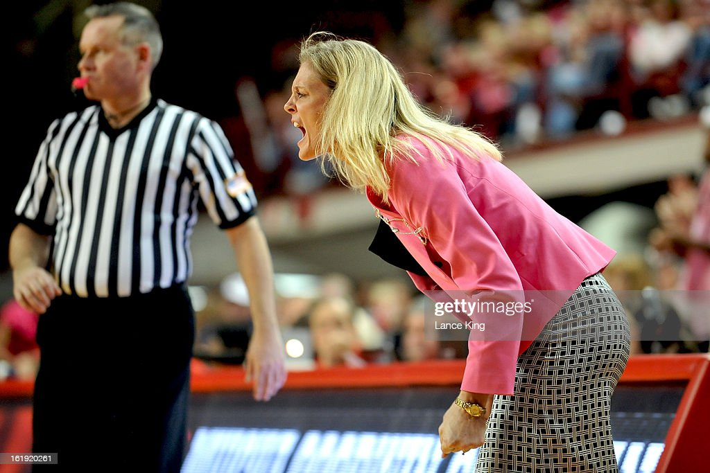 Head Coach Kellie Harper of the North Carolina State Wolfpack reacts to a play against the Georgia Tech Yellow Jackets at Reynolds Coliseum on February 17, 2013 in Raleigh, North Carolina.