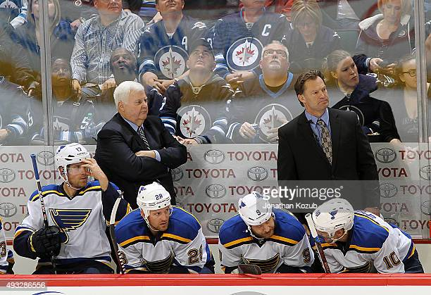 Head Coach Ken Hitchcock and Assistant Coach Kirk Muller of the St Louis Blues keep an eye on the play from the bench during third period action...