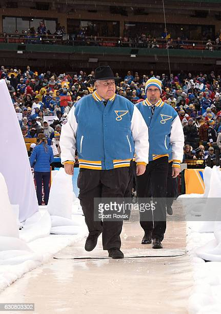 Head Coach Ken Hitchcock and Assistant Coach Mike Yeo of the St Louis Blues head to the ice prior to the 2017 Bridgestone NHL Winter Classic at Busch...