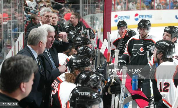 Head coach Ken Hitchcock of the Philadelphia Flyers gives instructions during a third peorid time out in a game against the New Jersey Devils March...
