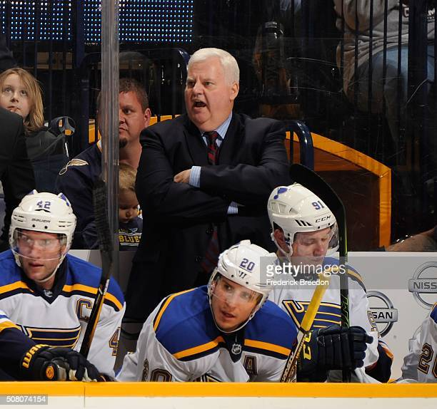 Head coach Ken Hitchcock of the St Louis Blues coaches against the Nashville Predators during the first period at Bridgestone Arena on February 2...