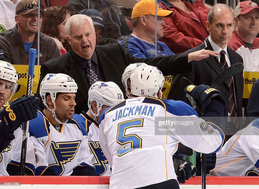 Head coach Ken Hitchcock of the St Louis Blues gives instruction to defenseman Barret Jackman #5 during a break in second period action at Jobing.com Arena on March 7, 2013 in Glendale, Arizona.