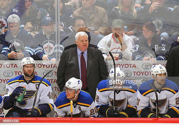 Head Coach Ken Hitchcock of the St Louis Blues looks on from the bench behind David Backes Alexander Steen Jori Lehtera and Patrik Berglund during...
