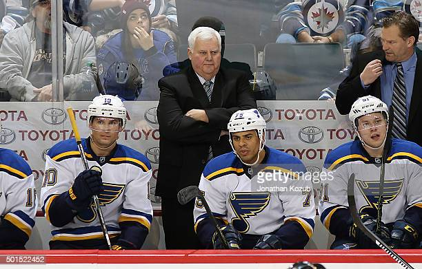 Head Coach Ken Hitchcock of the St Louis Blues looks on from the bench during third period action against the Winnipeg Jets at the MTS Centre on...