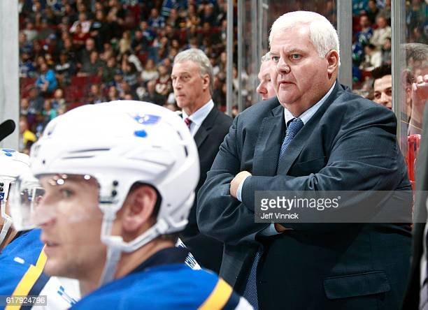 Head coach Ken Hitchcock of the St Louis Blues looks on from the bench during their NHL game against the Vancouver Canucks at Rogers Arena October 18...