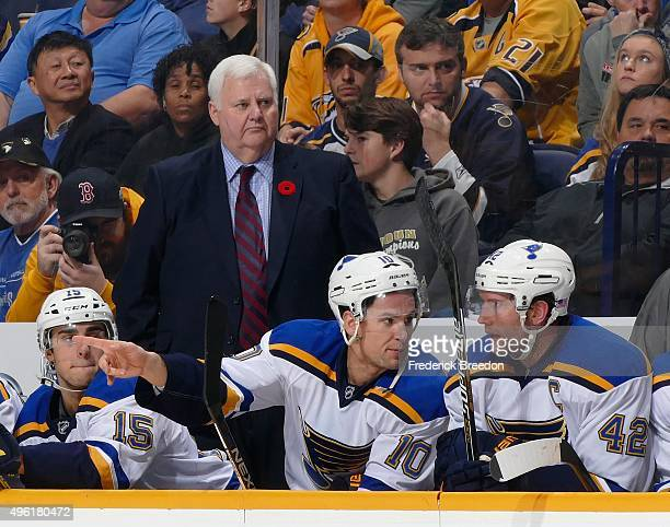 Head coach Ken Hitchcock watches from the bench during a game against of the Nashville Predators in the second period at Bridgestone Arena on...