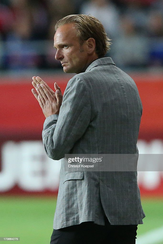 Head coach Kenneth Heiner-Moeller of Denmark looks thoughtful during the UEFA Women's EURO 2013 Group A match between Denmark and Finland at Gamla Ullevi Stadium on July 16, 2013 in Gothenburg, Sweden. The match between Denmark and Finland ended 1-1.