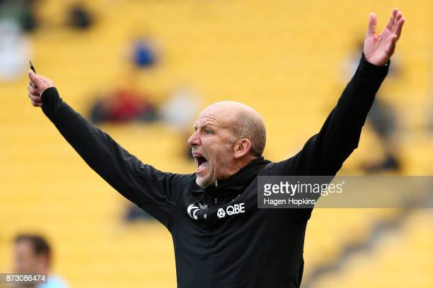 Head coach Kenny Lowe of the Glory talks to his players during the round six ALeague match between the Wellington Phoenix and the Perth Glory at...