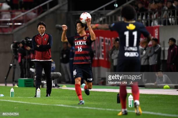 Head coach Kenta Hasegawa of Gamba Osaka looks on during the JLeague J1 match between Kashima Antlers and Gamba Osaka at Kashima Soccer Stadium on...