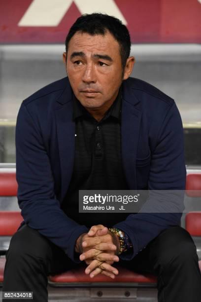 Head coach Kenta Hasegawa of Gamba Osaka looks on prior to the JLeague J1 match between Kashima Antlers and Gamba Osaka at Kashima Soccer Stadium on...