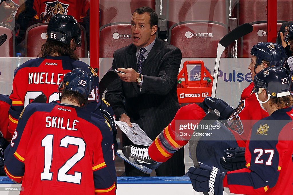 Head Coach <a gi-track='captionPersonalityLinkClicked' href=/galleries/search?phrase=Kevin+Dineen&family=editorial&specificpeople=654130 ng-click='$event.stopPropagation()'>Kevin Dineen</a> of the Florida Panthers directs his team during a break in the action against the Toronto Maple Leafs at the BB&T Center on February 18, 2013 in Sunrise, Florida.