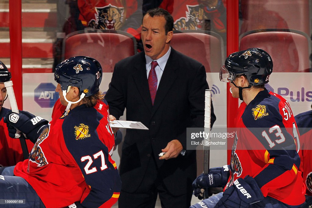 Head Coach Kevin Dineen of the Florida Panthers directs his team from the bench against the Ottawa Senators at the BB&T Center on January 24, 2013 in Sunrise, Florida.