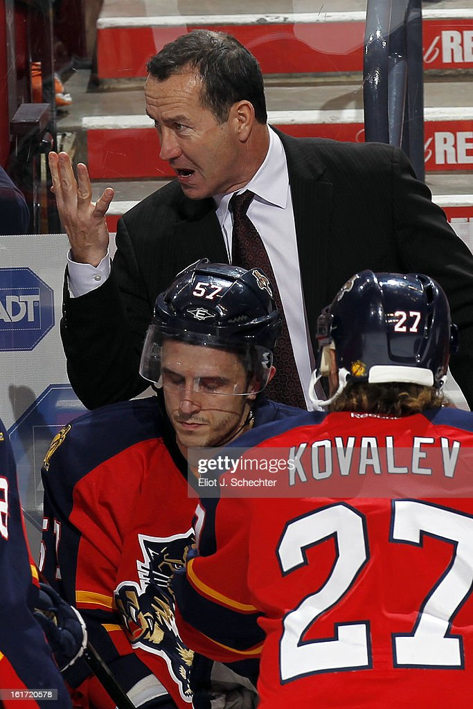 Head coach <a gi-track='captionPersonalityLinkClicked' href=/galleries/search?phrase=Kevin+Dineen&family=editorial&specificpeople=654130 ng-click='$event.stopPropagation()'>Kevin Dineen</a> of the Florida Panthers directs his team from the bench against the Montreal Canadiens at the BB&T Center on February 14, 2013 in Sunrise, Florida.