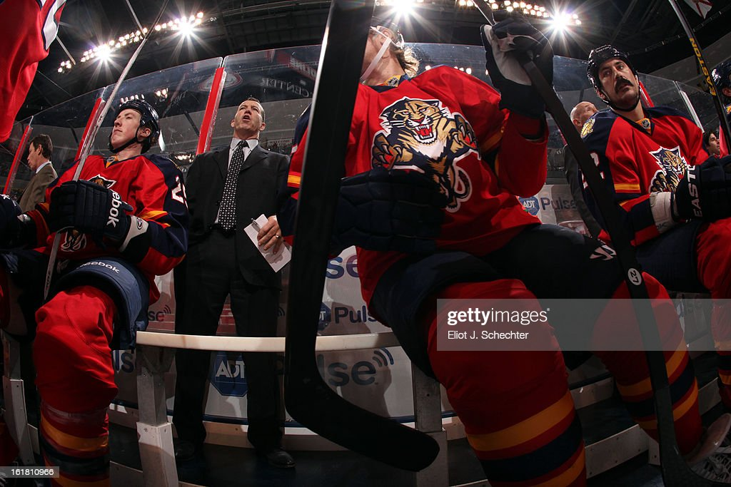 Head Coach <a gi-track='captionPersonalityLinkClicked' href=/galleries/search?phrase=Kevin+Dineen&family=editorial&specificpeople=654130 ng-click='$event.stopPropagation()'>Kevin Dineen</a> of the Florida Panthers directs his team from the bench against the Tampa Bay Lightning at the BB&T Center on February 16, 2013 in Sunrise, Florida.