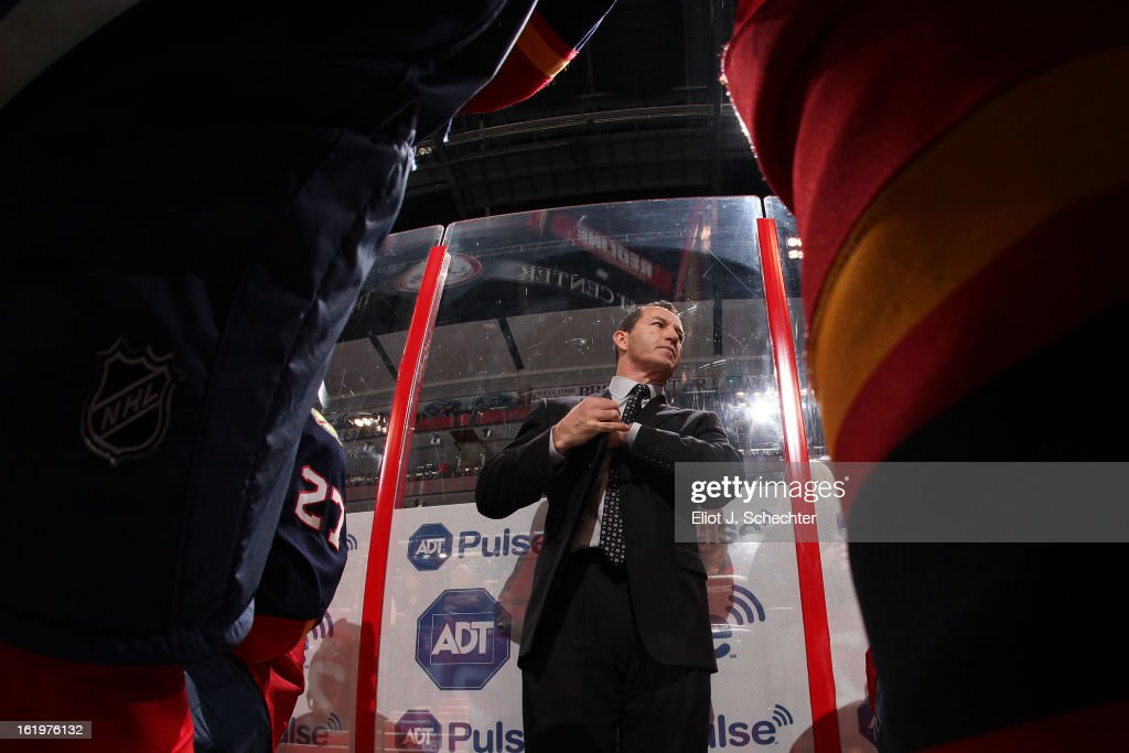 Head Coach Kevin Dineen of the Florida Panthers directs his team from the bench against the Tampa Bay Lightning at the BB&T Center on February 16, 2013 in Sunrise, Florida.
