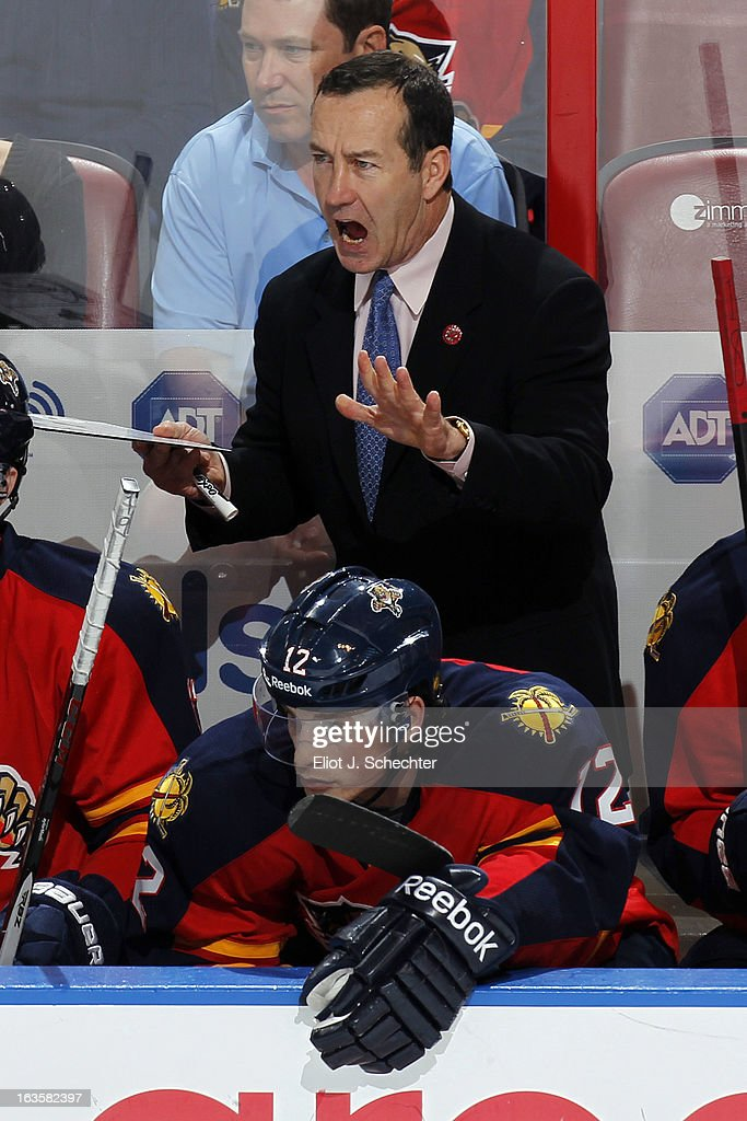 Head Coach <a gi-track='captionPersonalityLinkClicked' href=/galleries/search?phrase=Kevin+Dineen&family=editorial&specificpeople=654130 ng-click='$event.stopPropagation()'>Kevin Dineen</a> of the Florida Panthers directs his team from the bench against the Tampa Bay Lightning at the BB&T Center on March 12, 2013 in Sunrise, Florida.