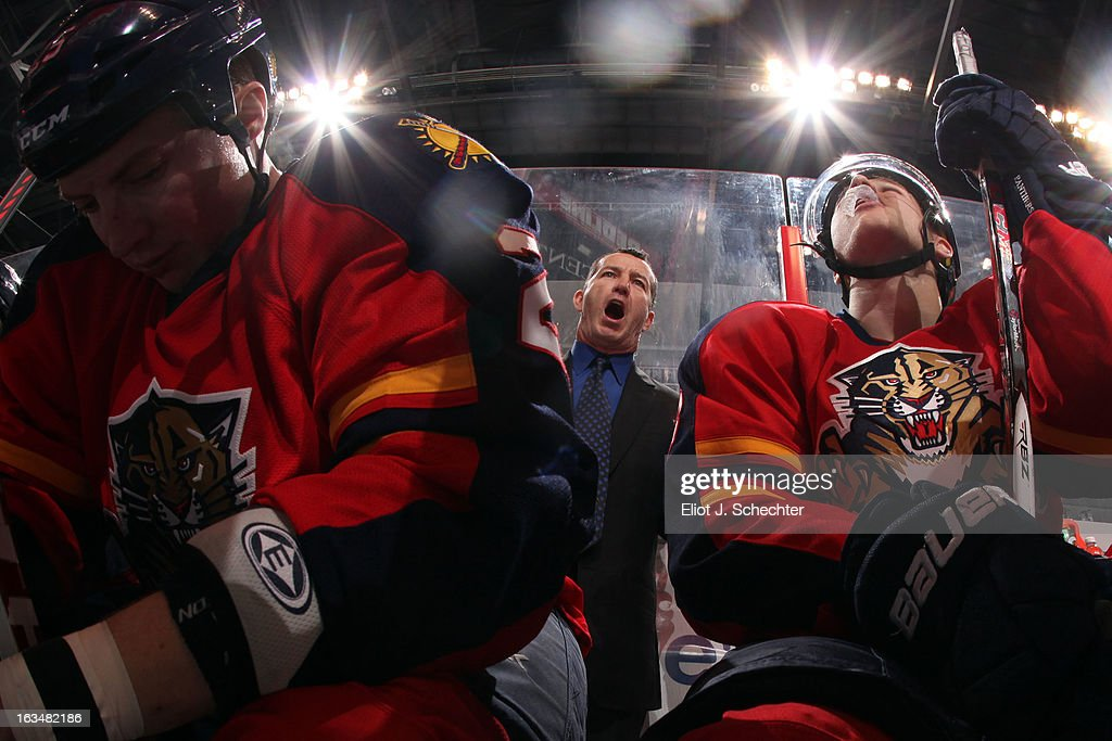Head Coach <a gi-track='captionPersonalityLinkClicked' href=/galleries/search?phrase=Kevin+Dineen&family=editorial&specificpeople=654130 ng-click='$event.stopPropagation()'>Kevin Dineen</a> of the Florida Panthers directs his team against the Montreal Canadiens at the BB&T Center on March 10, 2013 in Sunrise, Florida.
