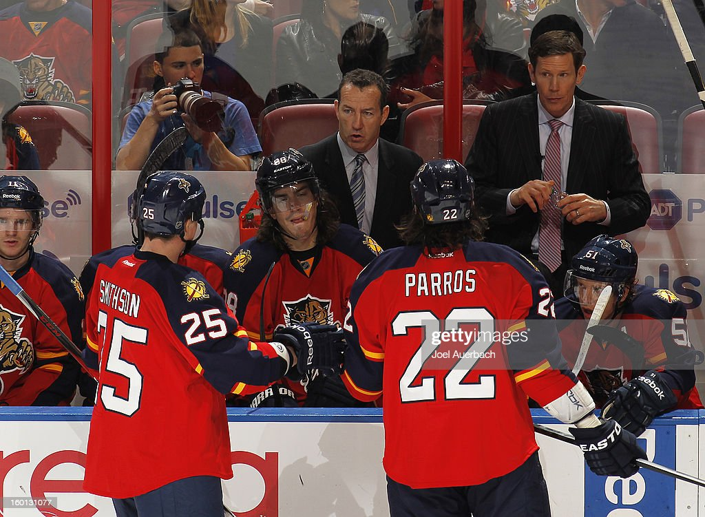 Head coach <a gi-track='captionPersonalityLinkClicked' href=/galleries/search?phrase=Kevin+Dineen&family=editorial&specificpeople=654130 ng-click='$event.stopPropagation()'>Kevin Dineen</a> of the Florida Panthers directs the players during a time out against the Philadelphia Flyers at the BB&T Center on January 26, 2013 in Sunrise, Florida. The Flyers defeated the Panthers 7-1. Photo by Joel Auerbach/Getty Images)