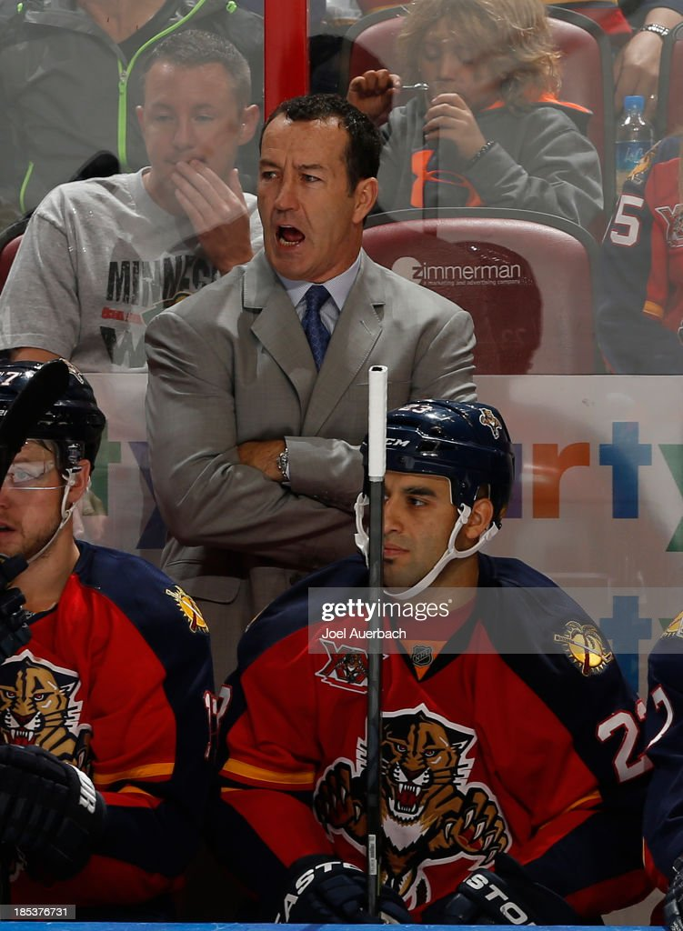 Head coach <a gi-track='captionPersonalityLinkClicked' href=/galleries/search?phrase=Kevin+Dineen&family=editorial&specificpeople=654130 ng-click='$event.stopPropagation()'>Kevin Dineen</a> of the Florida Panthers directs the players during third period action against the Minnesota Wild at the BB&T Center on October 19, 2013 in Sunrise, Florida. The Panthers defeated the Wild 2-1 in a shoot-out.