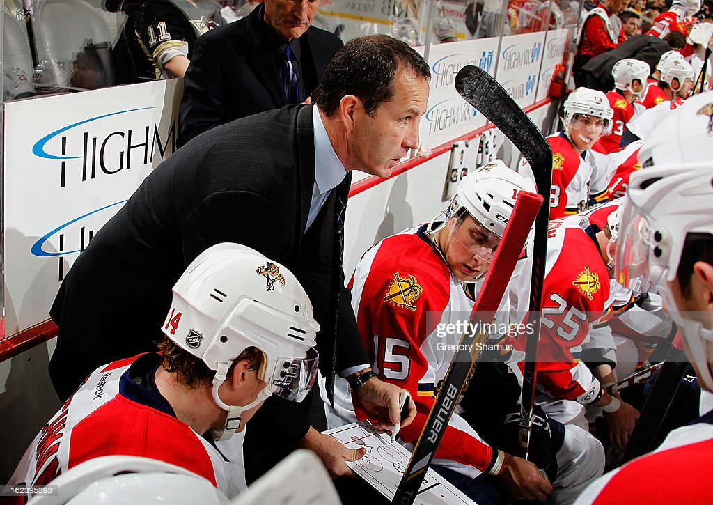Head Coach Kevin Dineen of the Florida Panthers gives instructions during the game against the Florida Panthers on February 22, 2013 at Consol Energy Center in Pittsburgh, Pennsylvania.
