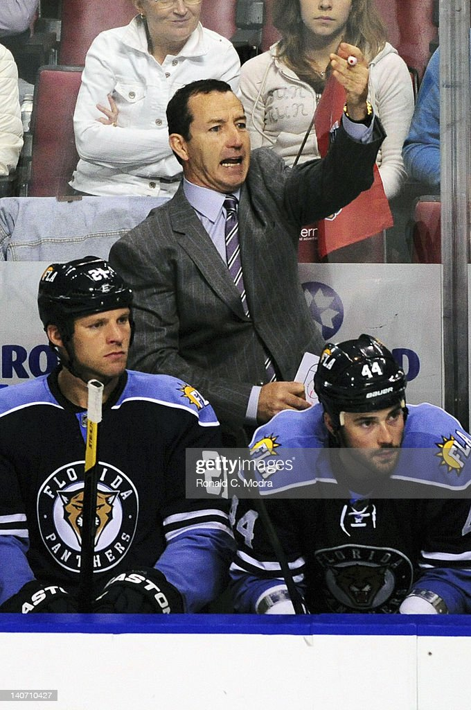Head coach <a gi-track='captionPersonalityLinkClicked' href=/galleries/search?phrase=Kevin+Dineen&family=editorial&specificpeople=654130 ng-click='$event.stopPropagation()'>Kevin Dineen</a> of the Florida Panthers reacts during a NHL game against the Montreal Canadiens at the BankAtlantic Center on February 26, 2012 in Sunrise, Florida.