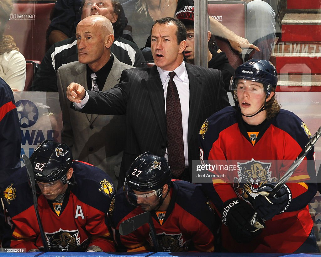Head coach <a gi-track='captionPersonalityLinkClicked' href=/galleries/search?phrase=Kevin+Dineen&family=editorial&specificpeople=654130 ng-click='$event.stopPropagation()'>Kevin Dineen</a> of the Florida Panthers reacts during third period action against the New York Rangers on December 30, 2011 at the BankAtlantic Center in Sunrise, Florida. The Rangers defeated the Panthers 4-1.