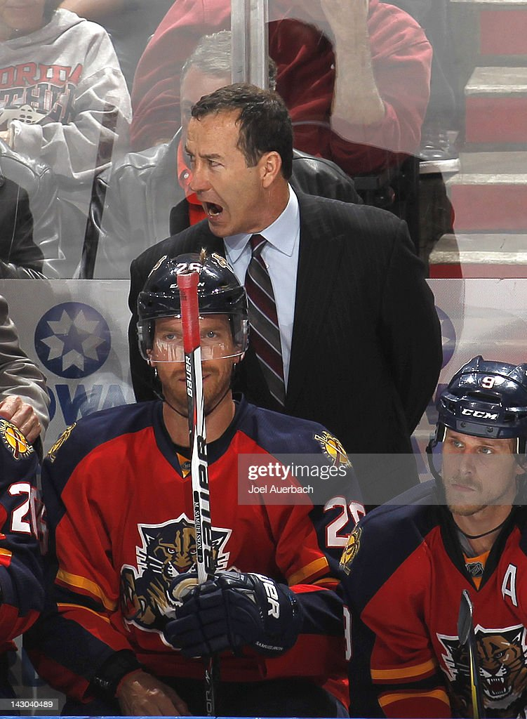 Head coach <a gi-track='captionPersonalityLinkClicked' href=/galleries/search?phrase=Kevin+Dineen&family=editorial&specificpeople=654130 ng-click='$event.stopPropagation()'>Kevin Dineen</a> of the Florida Panthers reacts to action against the New Jersey Devils in the third period in Game Two of the Eastern Conference Quarterfinals during the 2012 NHL Stanley Cup Playoffs at the BankAtlantic Center on April 15, 2012 in Sunrise, Florida. The Panthers defeated the Devils 4-2.