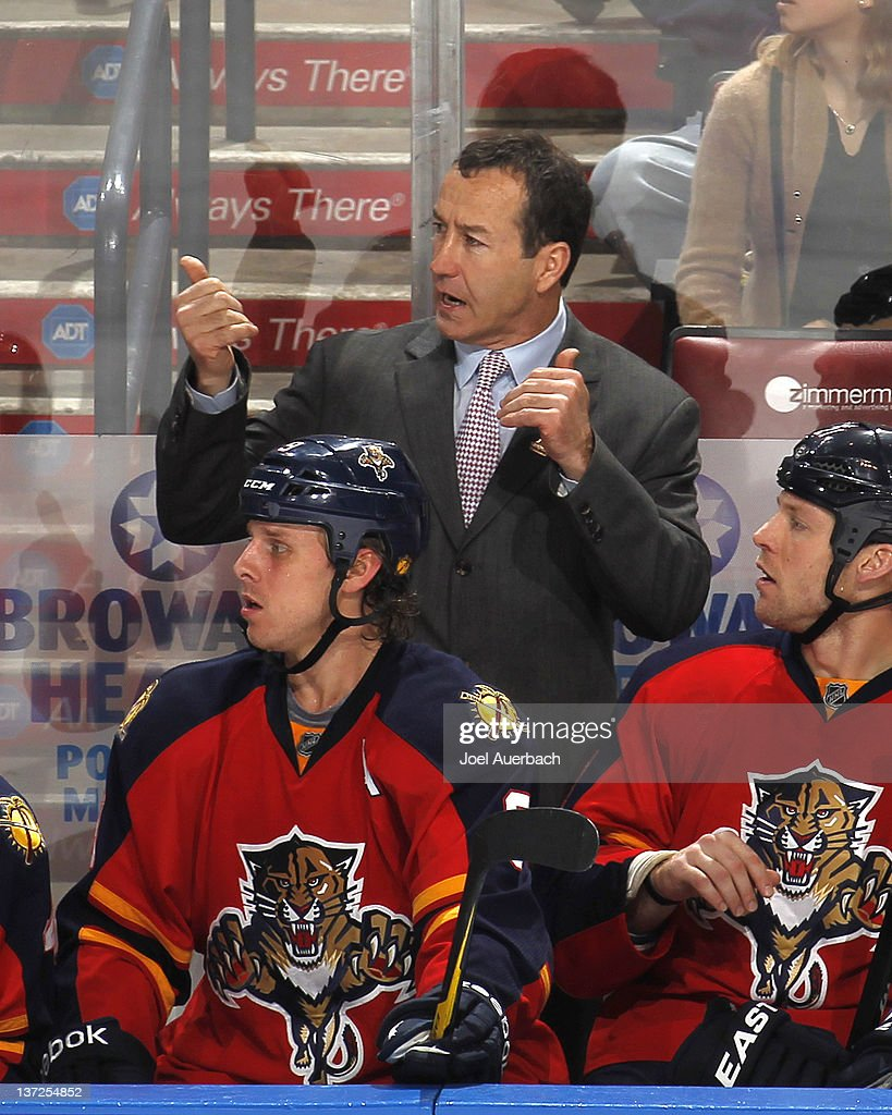 Head coach <a gi-track='captionPersonalityLinkClicked' href=/galleries/search?phrase=Kevin+Dineen&family=editorial&specificpeople=654130 ng-click='$event.stopPropagation()'>Kevin Dineen</a> of the Florida Panthers reacts to third period action against the Boston Bruins on January 16, 2012 at the BankAtlantic Center in Sunrise, Florida. The Bruins defeated the Panthers 3-2 in a shoot out.