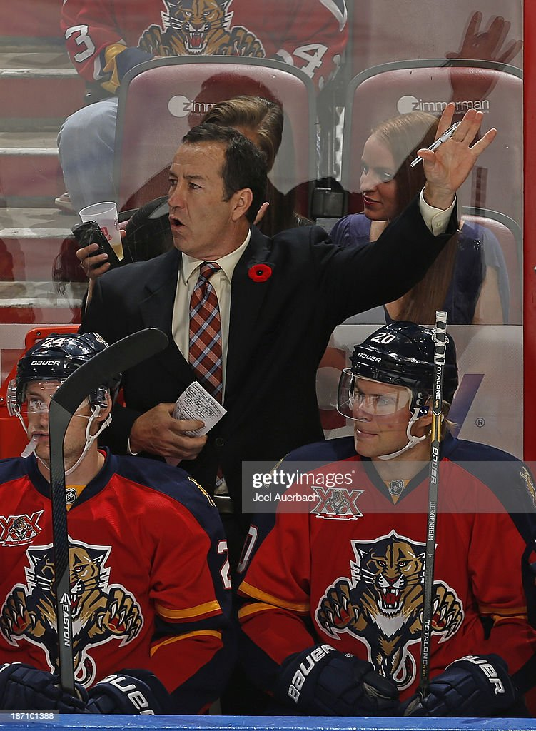 Head coach Kevin Dineen of the Florida Panthers reacts to third period action against the Edmonton Oilers at the BB&T Center on November 5, 2013 in Sunrise, Florida. The Oilers defeated the Panthers 4-3 in overtime.